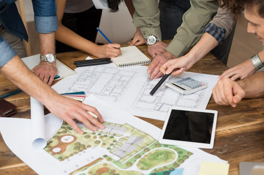Plan a Website for Interior Designers - Architect or interior design team discussing on blueprints