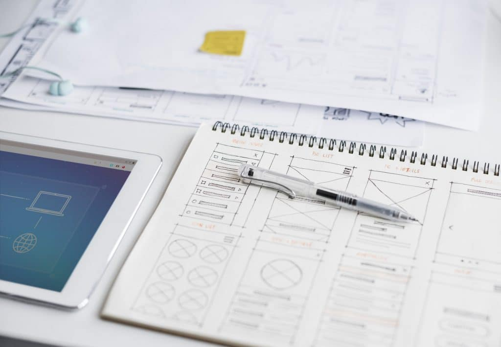 Plan a Website for Interior Designers Pen on notebook with web layout content drawing