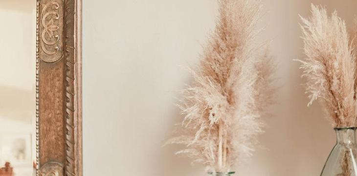 brown decorative plant in white vase.